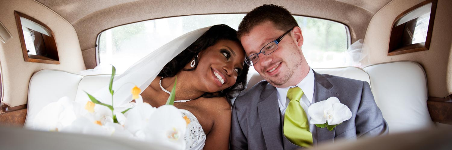 Couple sitting in car after getting married